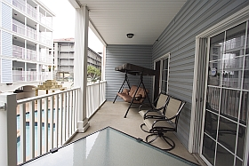 Sky Blue Vacation Condo, Myrtle Beach - Lower Balcony with three person swing, table, four chairs