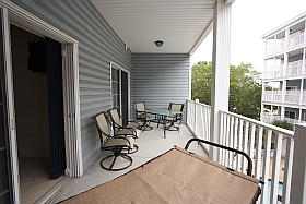 Sky Blue Vacation Condo, Myrtle Beach - Upper Balcony with hammock, table four chairs